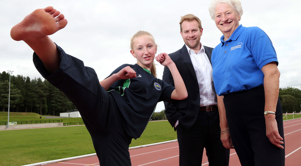 Taek that: Dame Mary Peters and Stuart Carson from Rainbow Communications congratulate Rachel McCune on receiving the Rainbow Communications Sports Award in partnership with the Mary Peters Trust