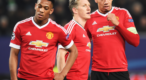 Euro flops: Anthony Martial, Bastian Schweinsteiger and Chris Smalling are dejected as United drop out of the Champions League