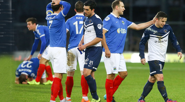 Pressure: Linfield players show their frustration during the draw with Ballinamallard, which was another blow for David Healy
