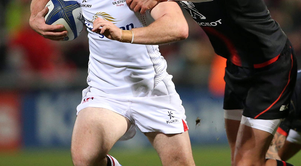 Holding off: Ulster ace Paddy Jackson attempts to escape from Toby Flood's grasp against Toulouse at the Kingspan Stadium