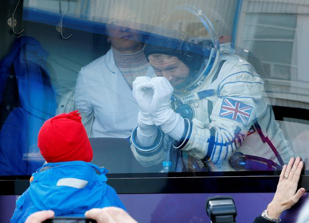 British astronaut Tim Peake says goodbye to his son before the launch of Soyuz TMA-19M space ship at the Russian leased Baikonur cosmodrome, Kazakhstan, Tuesday, Dec. 15, 2015. (AP Photo/Dmitry Lovetsky, Pool)