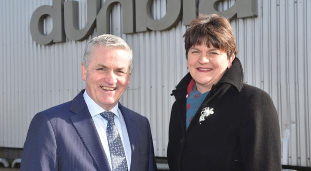 Finance Minister Arlene Foster (right) is pictured with Jim Dobson, managing director of Dunbia. Pic Simon Graham/Harrison Photography