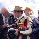 Jimmy Walker interviews Robert Dunlop after Robert won the 125cc race at the Ulster Grand Prix in 2000.