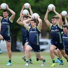 On the ball: Ireland's International Rules squad work on their conditioning ahead of a Test with Australia