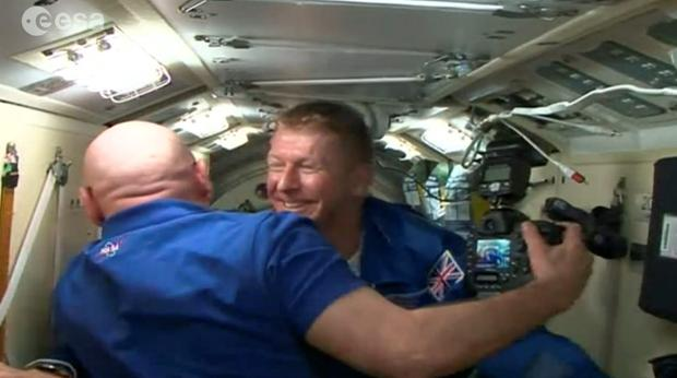 Screen grabbed image taken from footage issued by European Space Agency of British astronaut Major Tim Peake emerging from the Soyuz space capsule hatch at the the International Space Station (ISS).PA