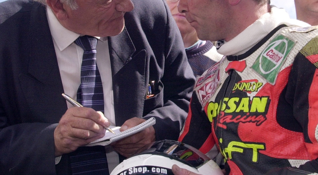 By the book: Jimmy Walker interviews Robert Dunlop after the Ballymoney man won 125cc race at the 2000 Ulster Grand Prix