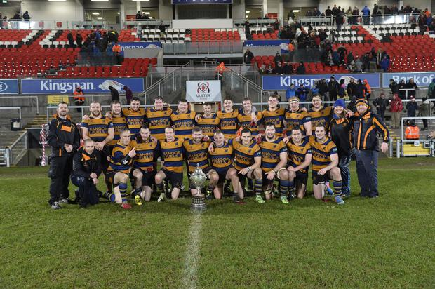 Prize guys: Bangor pose with the Millar McCall Wylie Junior Cup after winning the crown for the first time by beating Instonians 7-5 at the Kingspan Stadium last night