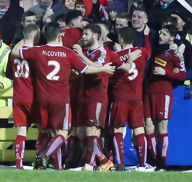 Red alert: Jay Donnelly is mobbed by Cliftonville team mates after his extra-time winner against Warrenpoint at Milltown