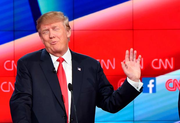 Republican presidential candidate, businessman Donald Trump, gestures during the Republican Presidential Debate, hosted by CNN, at The Venetian Las Vegas on December 15, 2015 in Las Vegas, Nevada. AFP/Getty Images