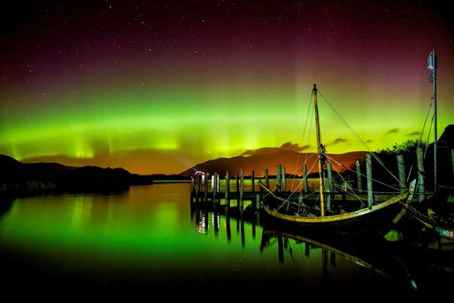 File photo dates 08/10/15 of the Northern Lights, or Aurora Borealis, shining over Derwentwater, near Keswick in the Lake District. Owen Humphreys/PA