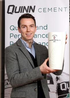 Tony Kernan, November winner of the UGAAWA Quinn Building Products Merit Award, with his Belleek Living Vase