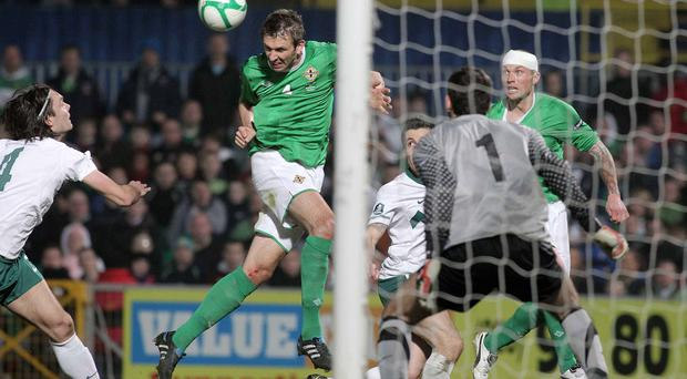 Slo close: Gareth McAuley heads wide against Slovenia in 2011