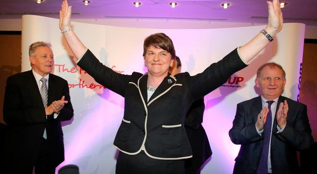 Arlene Foster, Northern Ireland Finance Minister smiles at a hotel in Belfast after being elected leader of the Democratic Unionist Party (DUP) on December 17, 2015. AFP/Getty Images