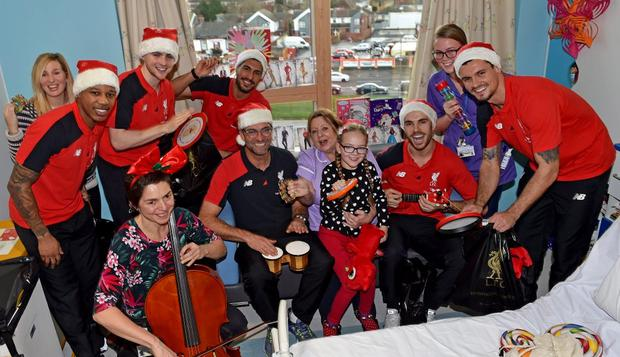 Liverpool team sings Jingle Bells at Alder Hey Hospital with Jurgen Klopp on bongos, Jordan Henderson on guitar. Image: Liverpool FC