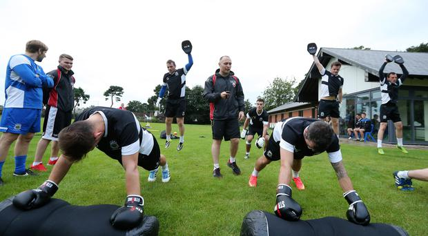New role: Brian Magee puts Linfield through their paces