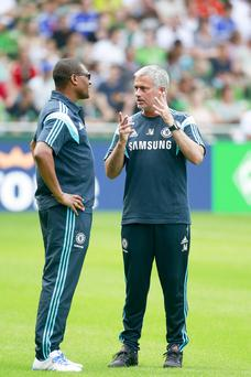 Happier times: Michael Emenalo and Jose Mourinho in discussion before the latter's sacking this week