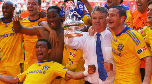 Familiar face: Guus Hiddink, who won the FA Cup during an interim spell with Chelsea in 2009, may now return to the club