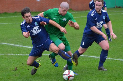 Action from Dundela v Downpatrick (photo by Andy Gray)