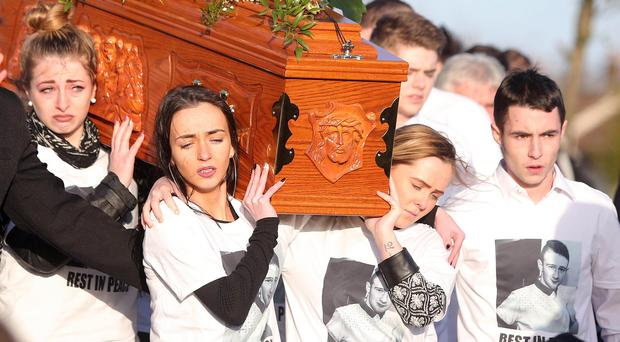 Funeral of murder victim Christopher Meli from his family home in Sliabh Dubh View in west Belfast. The 20-year-old father of one died after he was attacked by a gang of youths in Glasvey Close in the Twinbrook estate on 12 December. Christopher Meli's coffin leaves Requiem Mass in New Barnsley for burial. Picture by Jonathan Porter/PressEye