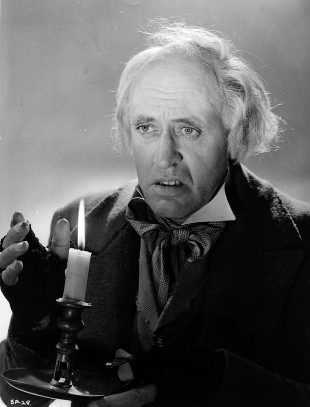 1951: Scottish actor Alastair Sim (1900 - 1976) plays the title role in the film 'Scrooge' (aka 'A Christmas Carol'), directed by Brian Desmond Hurst for Renown.. Edinburgh-born Sim, a former elocution professor, made his stage debut aged 30 and quickly progressed to films in 1935 appearing in five in his first year. He was a character actor who was equally successful in drama and comedy roles. He starred in many films including 'The Belles of St Trinian's' (1954) and 'An Inspector Calls' (1954). He also continued to work in the theatre, directing and acting in various James Bridie plays and frequently played Captain Hook by popular request. (Photo by Hulton Archive/Getty Images)