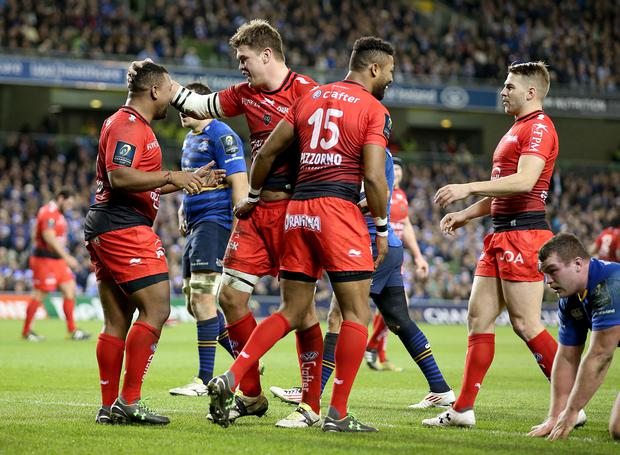 Tou good: Toulon's Juan Smith celebrates his try against Leinster with Delon Armitage, Steffon Armitage and Drew Mitchell at the Aviva Stadium