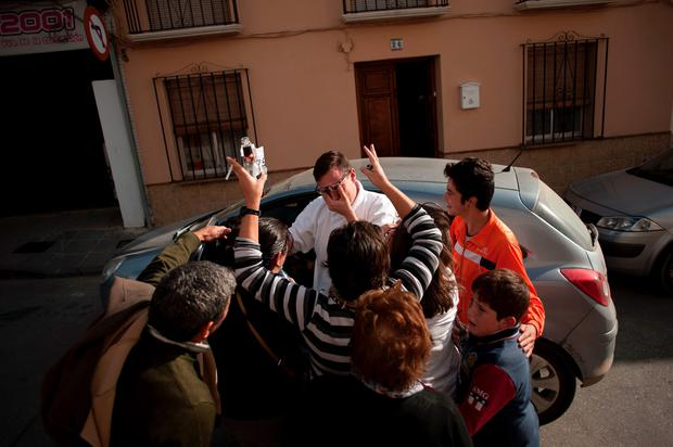 A group of people celebrate in a street of Villanueva de la Concepcion, near Malaga, as they hold a ticket wlth the first prize of the Spain's Christmas lottery named