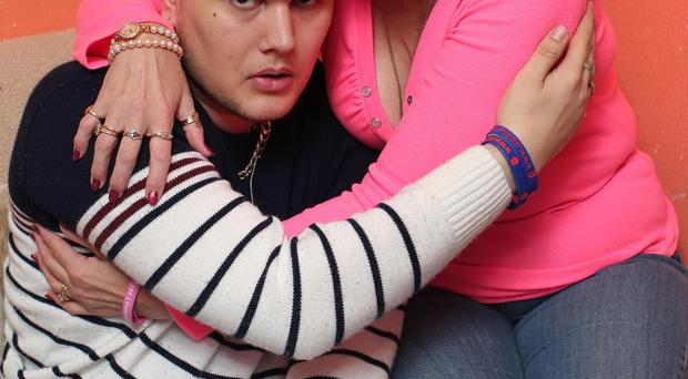 Attack victim Scott Vineer is hugged by his mother Helen-Louise Doney