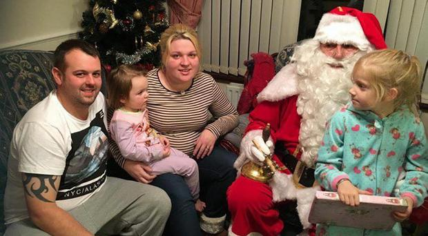 Twitter picture of Santa visiting the Peden family after the fire