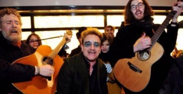 Glen Hansard, Bono and Hozier busking on Grafton Street in Dublin