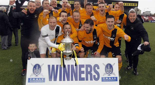 2015 Toals Bookmakers Steel & Sons Cup winners Harland & Wolff Welders celebrate with the famous old trophy after beating Albert Foundry on penalties