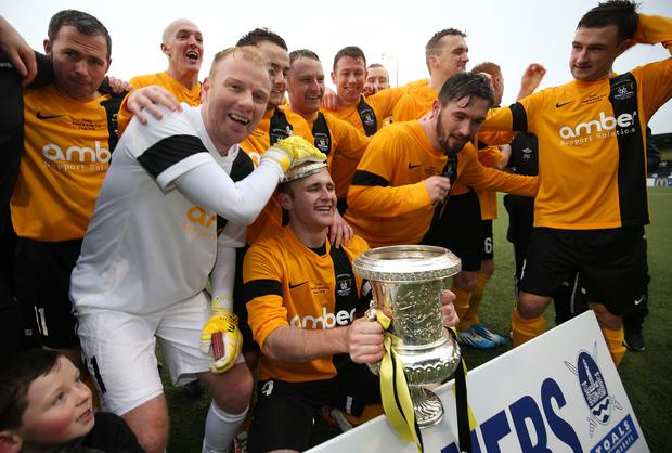 Weld done: Harland and Wolff Welders' players celebrate their penalty shootout win over battling Albert Foundry in the Christmas Day Steel Cup final at Seaview
