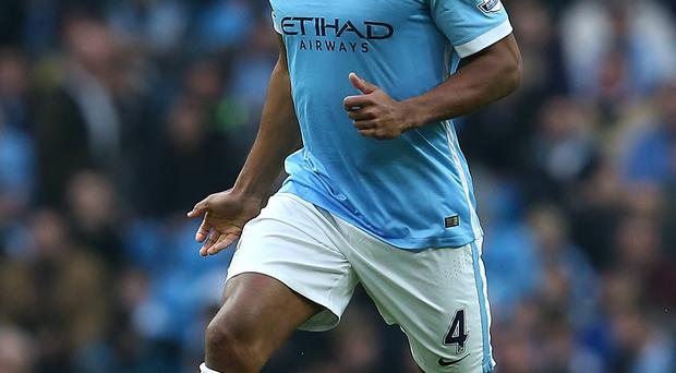 Captain fantastic: Vincent Kompany comes back today against Sunderland to boost Manchester City's quest for honours