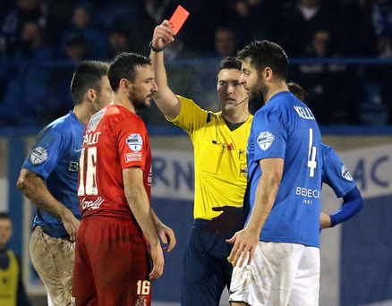 Off you go: Referee Ian McNabb sends off Portadown ace Michael Gault after his second yellow card