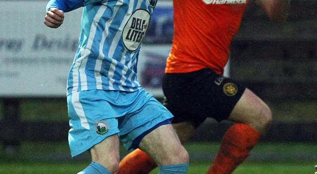 On the ball: Daniel Hughes will now link up with Cliftonville