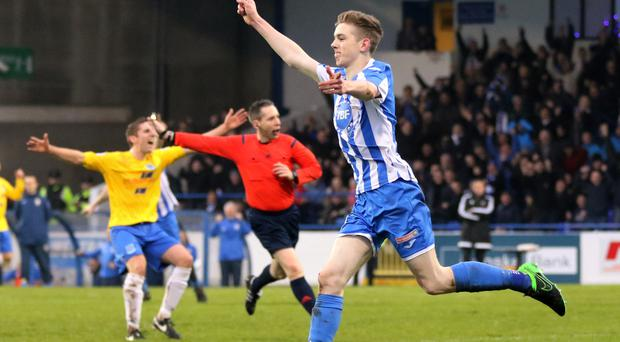 Main man: Coleraine star Jamie McGonigle wheels away to celebrate his deadly double at the Showgrounds
