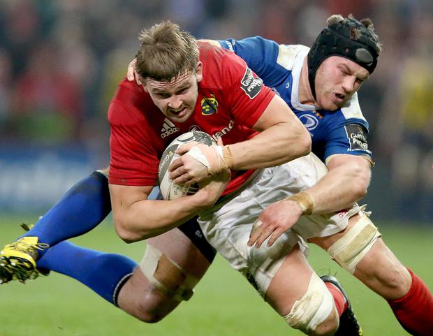 Holding on: Munster's Dave Foley is pulled back by Sean O'Brien of Leinster in their Pro12 battle yesterday