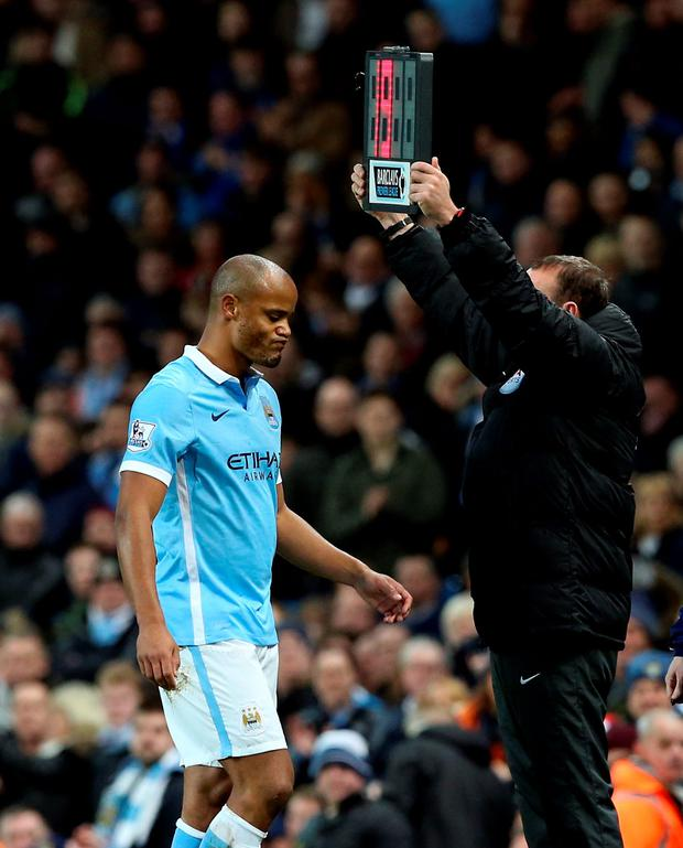 Failed comeback: Manchester City captain Vincent Kompany leaves the field injured just nine minutes after coming on as sub