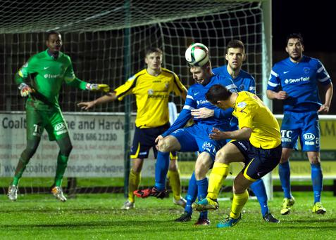 Head boy: Swifts' Gary Liggett fires home to salvage a draw but Mallards boss Whitey Anderson is proud of his men