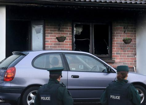 PSNI officers at the scene of a house fire at Silverhill Park in Enniskillen. Pic: John McVitty.