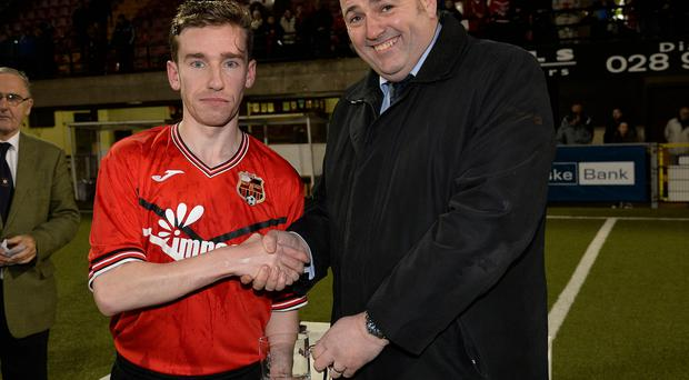 East Belfast's Luke Wilson accepts the man of the match award from Conrad Kirkwood