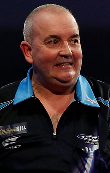 Big hit: Phil Taylor fought back to see off Kevin Painter