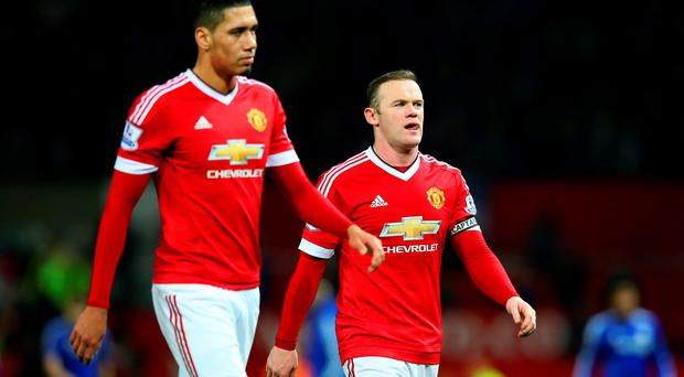 Familiar sight: Chris Smalling and Wayne Rooney trudge off after the clash with Chelsea — their seventh goalless draw this term