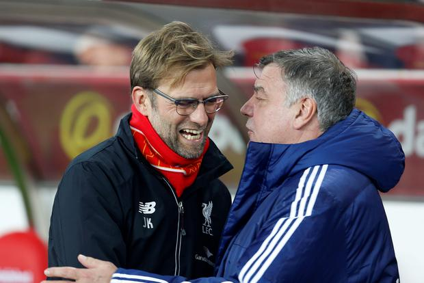 Eye to eye: Liverpool manager Jurgen Klopp (left) shares a joke with Sunderland boss Sam Allardyce