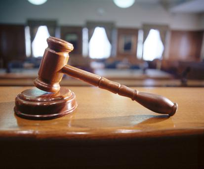 A Larne man has appeared in court and ordered to keep his curtains closed at night after exposing himself.