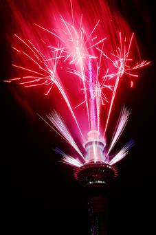 A fireworks display is launched from the Auckland Sky Tower during New Year's Eve celebrations on January 1, 2016 in New Zealand. (Photo by Hannah Peters/Getty Images)