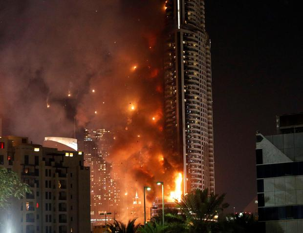 Flames rip through the Address Downtown hotel after it was hit by a massive fire, near the world's tallest tower, Burj Khalifa, in Dubai, on December 31, 2015. AFP/Getty Images