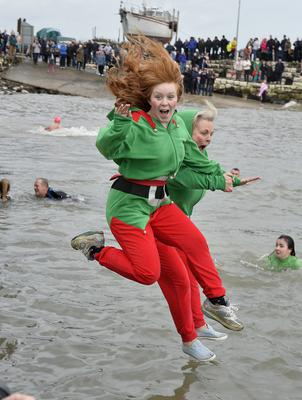 Blaze and Jill Lambert  take the plunge at the annual New Year's Day swim at Carnlough harbour.