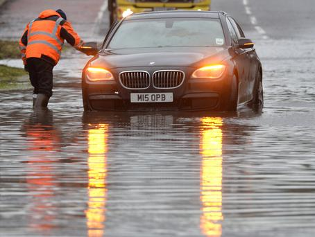 A recovery truck rescues a broken down car on the Moira Road in Co Antrim after Storm Frank hits across Northern Ireland