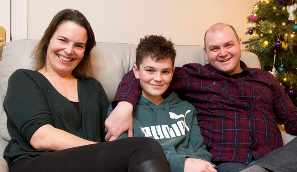 Pacemaker press 01/01/16 Darren Hutton with his wife Loraine and son Joel pictured at their Newtownards home. Darren helped by his son Joel saved a women from certain death after she fell into the flooded river lagan in Lisburn and helping her to safety. Picture Mark Marlow/pacemakler press