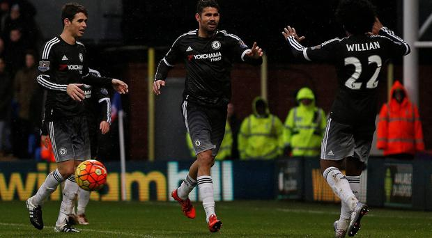 Chelsea's Brazilian-born Spanish striker Diego Costa (C) celebrates scoring his team's third goal with Chelsea's Brazilian midfielder Oscar (L) and Chelsea's Brazilian midfielder Willian during the English Premier League football match between Crystal Palace and Chelsea at Selhurst Park in south London on January 3, 2016. AFP PHOTO / ADRIAN DENNIS
